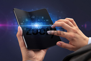 Businessman holding a foldable smartphone, security concept