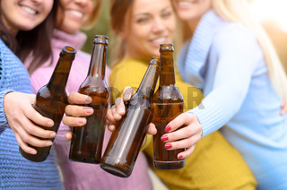Group of young woman toasting with bottle of beer