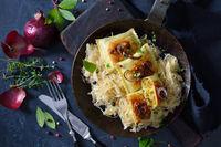 Fried stuffed Swabian ravioli with sauerkraut