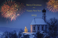 fireworks at Silvester and new year`s day 2019 at romantic chapel with illuminated Xmas tree