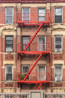 Red fire escape of an apartment building in New York city