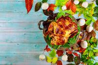 Thanksgiving dinner with turkey, apple pie, pumpkin.