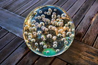 Old glass ball on a wooden table