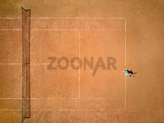 Sportive girl plays tennis