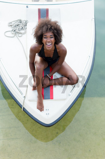 afro woman relaxing on a speedboat.
