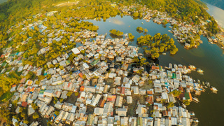 Aerial view Coron city with slums and poor district. Palawan. Bu