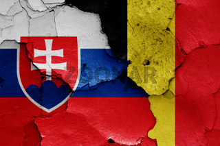 flags of Slovakia and Belgium painted on cracked wall