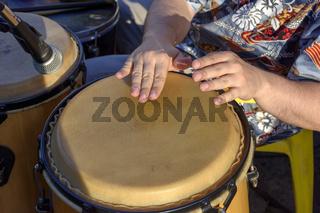 Brazilian samba hand drum in street carnival party