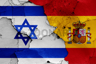 flags of Israel and Spain painted on cracked wall