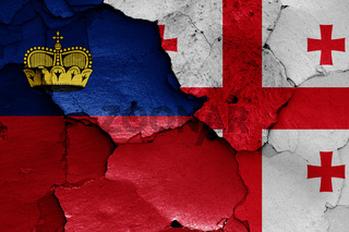 flags of Liechtenstein and Georgia painted on cracked wall