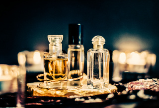 Perfume bottles and vintage fragrance at night, aroma scent, fragrant cosmetics and eau de toilette as luxury beauty brand, holiday fashion parfum design
