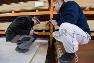 two young carpenters writing new prices