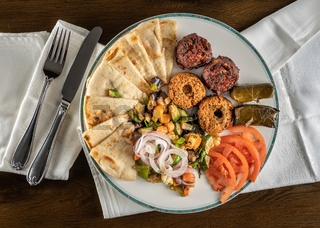 Flat lay of greek vegetarian mix take out food arranged on plate