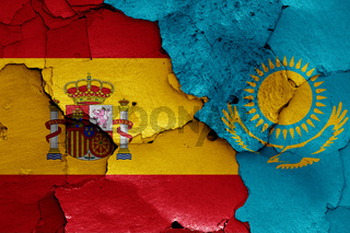 flags of Spain and Kazakhstan painted on cracked wall