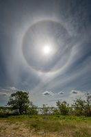 Halo around the sun in a layer of cirrostratus clouds over the Baltic sea viewed from the island of Öland, Sweden