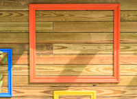 Colorful painted photo frame hanging on wooden pallet wall