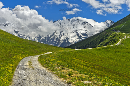 Hiking trail in front of the snow-covered Mont Blanc massif, Saint-Gervais-les-Bains, France