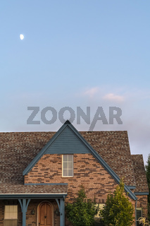 Face brick house with a steeply pitched roof