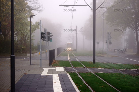 Tram in the fog
