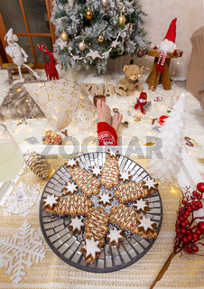 Christmas food and lots of Christmas decorations in front of Christmas tree