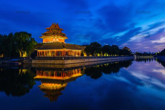 Beijing, China - JUN 27, 2014: Sunset at Forbidden City Moat, Corner Towers