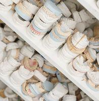 Piles of dentures on several shelves close up shot