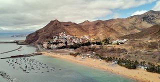 Aerial photography drone point of view of Playa de Las Teresitas beach picturesque distant view of mountainous terrain bright colors Atlantic Ocean, Santa Cruz de Tenerife, Canary Islands, Spain
