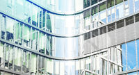 glass facade of modern office building - abstract business background  -