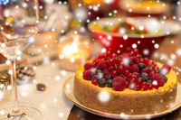close up of cake and other food on christmas table