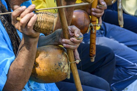 Traditional berimbau players during presentation of Brazilian capoeira