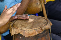 Brazilian woman hands playing ethnic drums in folk religious festival