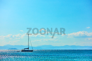 Lonely sail yacht in the sea