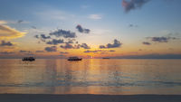 Sunset on the beach of the Maldives