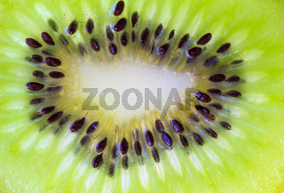 Kiwi fruit slice background - close up macro photo