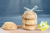 Cookies tied with rope, on gray-blue background