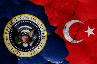 flags of President of the United States and Turkey painted on cracked wall
