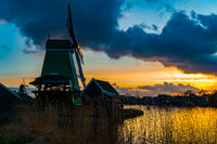 View of windmills at Zaanse Schans in Netherlands at sunset