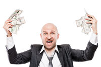 Businessman in black suit hand holding US dollar currency money