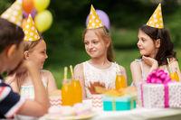 happy kids on birthday party at summer garden