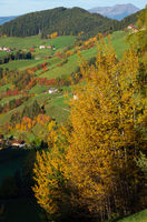 Autumn Santa Magdalena famous Italy Dolomites mountain village environs grassy hills. Picturesque traveling, seasonal and countryside beauty concept background.