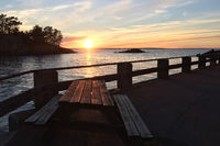 Sunset at Lake Vättern in Sweden with seating in the foreground