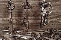 Metal keys hang on the hooks