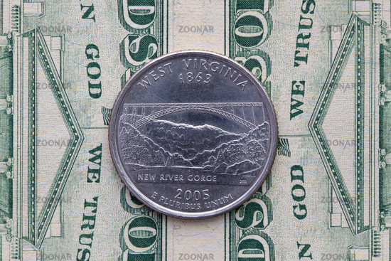 Symmetric composition of US dollar bills and a quarter of West Virginia