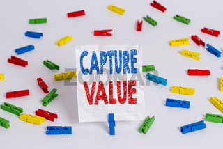 Text sign showing Capture Value. Conceptual photo Customer Relationship Satisfy Needs Brand Strength Retention Colored clothespin papers empty reminder white floor background office.