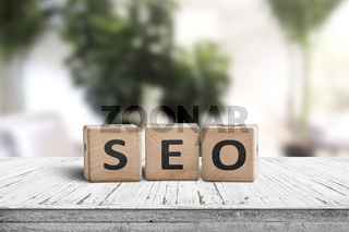 SEO word sign on a table in a bright room
