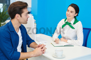 Smiling lady consultant communicating with client