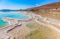 The shallow coast of the Dead Sea