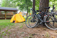 two bicycles and a yellow tourist tent, cyclists tourists camping