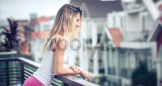Beautiful woman at the balcony