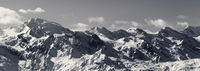 Panoramic view on snowy mountains in nice sunny evening